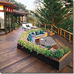 Large deck using planters to create separate spaces
